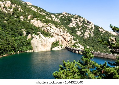 Qingdao, China: a lake in Ba Shui He trail in Mt. Laoshan in Summer. Laoshan mountain features some of the most ancient temples of all of China, and is one of Qingdao most popular attractions