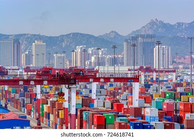 QINGDAO, CHINA - May 15, 2017: Qianwan container terminal with city skyline in the background at Qingdao.