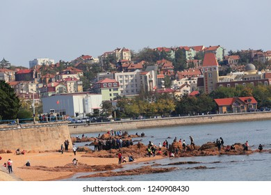 Qingdao, China - October 20, 2018: Tourists visiting the Olympic Sailing Center Pier in Qingdao China Shandong province.