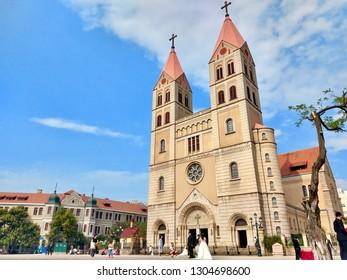 QINGDAO, CHINA, SEP 28, 2018: Qingdao Christian Church surround the German building style that is the tourist landmark at Qingdao, China