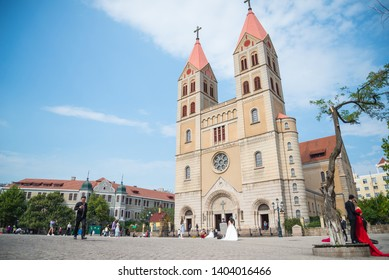 QINGDAO, CHINA, SEPTEMBER 28, 2018: Qingdao Christian Catholic Church is the colonisation worship from Germany style. Nowadays that is the tourist landmark in Qingdao, China