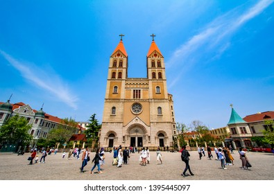 QINGDAO, SHANDONG, CHINA - MAY 11, 2019: Public square in front of St. Michael's Cathedral (Also known as Zhejiang Road Catholic Church) in Qingdao, China