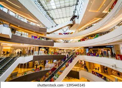 QINGDAO, SHANDONG, CHINA - MAY 11, 2019: Interior of Mixc shopping centre in downtown Qingdao near May 4th Square. It contains luxury brand and high end consumable stores