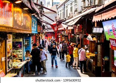 QINGDAO, SHANDONG, CHINA - MAY 11, 2019: Entrance of Pichai Yuan (Literally Firewood Courtyard), a famous food street in Qingdao downtown.