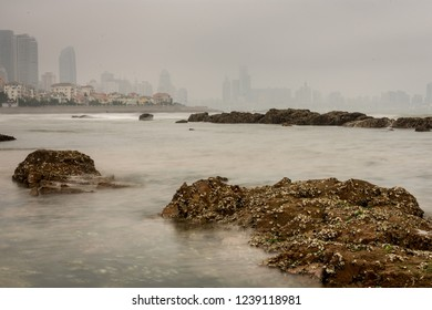 Qingdao, Shandong Province / China - August 6th 2015: Skyscrapers of Qingdao at the city waterfront, during a smoggy day.