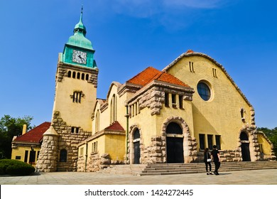 Qingdao, Shandong/china-5/11/2019: A couple passing the front of historic Christian Church of Qingdao designed by German missionary