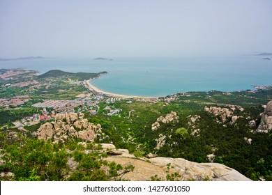 Qingdao, shangdong/china -5/13/2019: panoramic scenery of longevity peak with the background of laoshan bay in yangkou scenic area laoshan National Park Qingdao China