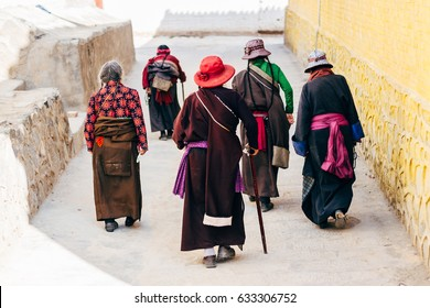 Qinghai, China - 8 October 2016: Local ladies in tibetan clothes - chuba and  colorful hats in buddhist Longwu (Rongwo) Monastery in Qinghai, China