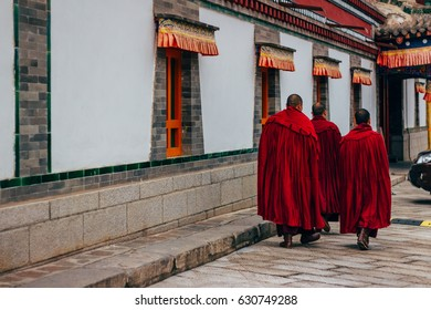 QINGHAI, CHINA - October 4, 2016: Tibetan monks in the ancient temple building architecture of Kumbum monastery in Qinghai Province, China