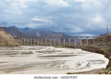 qinghai-tibet railway of china, railroad bridge on kunlun river and plateau scenery
