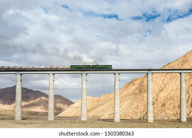 qinghai-tibet railway closeup, train on railroad bridge, China