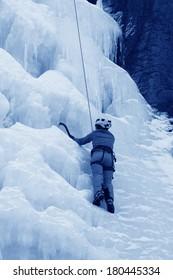 QINGLONG - JANUARY 18: Ice climbing enthusiasts use rope, climbing a frozen waterfall, on January 18, 2014, QingLong, hebei province, China.