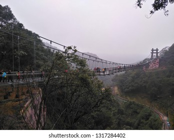 QingYuan GuangDong China-Feb 16,2019:people visting the glass bridge at GuLongXia QingYuan during Chinese New Year holidays.GuLongXia is famous for the glass bridge and platform.