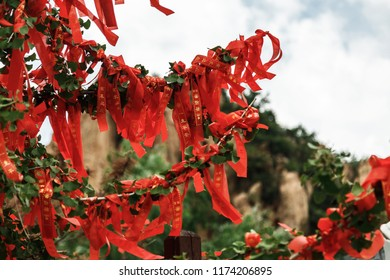 Qinhuangdao, Hebei / China. August 31, 2018. Chinese buddhist temple, traditional red ribbons with wishes. Life and travel in China
