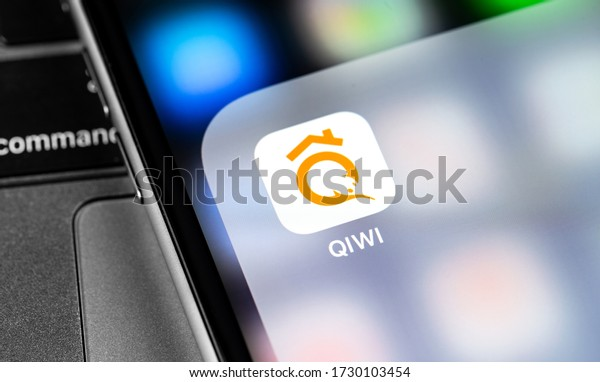 QIWI icon app on the screen smartphone and notebook closeup. QIWI Group is a Russian payment service. Moscow, Russia - March 24, 2020