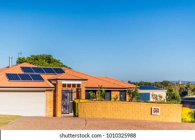 Qld, Australia, Jan 19, 2018: Array of solar panels on north facing roof of suburban house in sunny Queensland, installed to convert energy from sunlight into electricity and help reduce power bills.