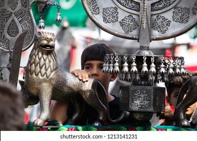Qom, Iran, 09/20/2018, Ashura - islamic holy day; azadari (mourning) rituals; the remembrance ceremonies for the martyrdom of Imam Hussain; shia muslims