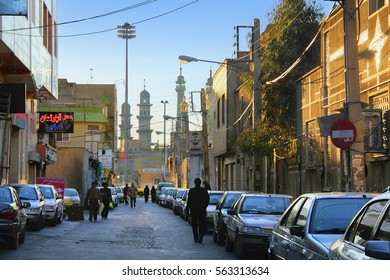 QOM, IRAN - JAN 07: Beautiful city view - Fatima Masumeh (Al-Masumah) Shrine and local people go along the street on January 7, 2017 in Qum - the holy place for Shia Muslims, Iran, Middle East