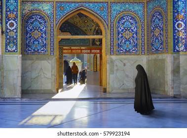 QOM, IRAN - JAN 07: Pilgrims go through the beautiful courtyard of Fatima Masumeh (Al-Masumah) Shrine and Azam Mosque on January 7, 2017 in Qum - the holy city for Shia Muslims, Iran, Middle East