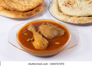 Qorma salan with bread on white background, Ramadan food, Indian iftar meal.