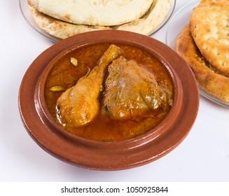 Qourma Salan, Indian food, Top view of Chicken Qorma dish with cardamom and Naan or sheermal on white background, Ramzan iftar meal, Delicious ramadan dinner.