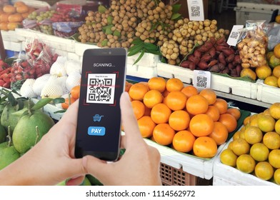 Qr code payment, E wallet , cashless technology concept. Man scanning tag Fresh Fruit in Market accepted generate digital pay without money.