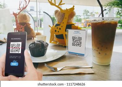 Qr code payment, E wallet , cashless technology concept. Man scanning tag in Coffee shop accepted generate digital pay without money.