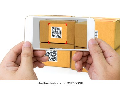 Qr code payment , online shopping , cashless technology concept. Hand using mobile phone application to scan qr code on parcel box.