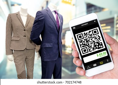 qr code payment technology , cashless concept. Customer use mobile phone to scan qrcode in retail fashion department store mall shop.