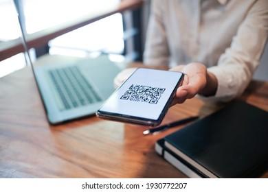 Qr code payment. Woman scanning QR code online shopping cashless technology concept