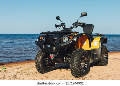 quad bike ATV, blue sea background