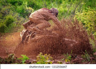 the quad bike is moving along the mud. Catching on quad bikes on impassability, a favorite occupation of extreme men in Russia.