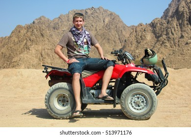 quad bike racer in desert