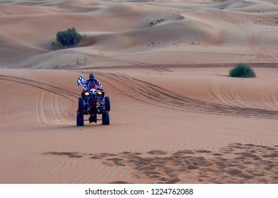 quad bike rider in the desert dubai