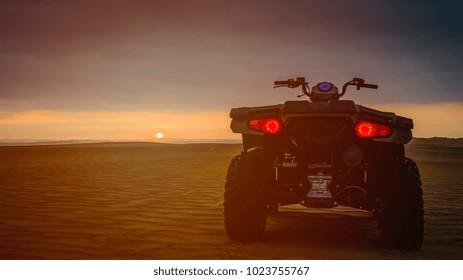 Quad Biking in the desert at sunset, Huacachina, Peru