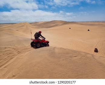 Quad biking outside of Swakopmund. Namib Rand sand dunes. Namibia, Africa.