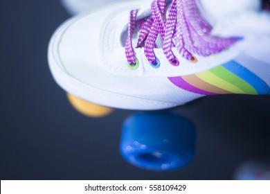 Quad four wheel  roller disco skates in retail skate shop window display on sale.