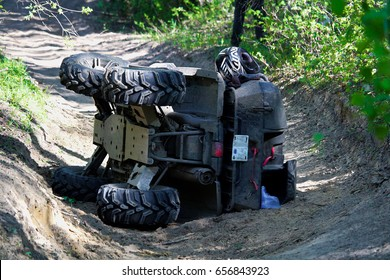 A quad on its side after it has been accidentally flipped.