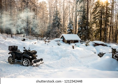 Quad as working tool in winter for snow clearing