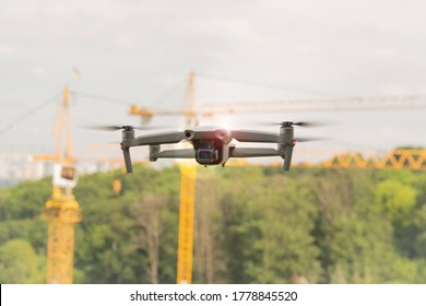 Quadcopter with camera. Aircraft. Drone. A small unmanned quadcopter flies in the sky