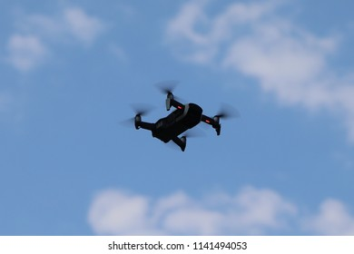 the quadcopter on the background of blue sky