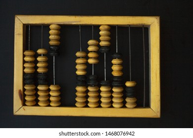 quadrangle frame abacus, item from wood, black background