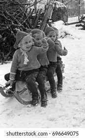 Quadraple Four girls playing in snow