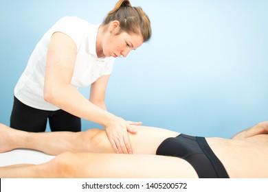 Quadriceps massage in a physiotherapist's studio