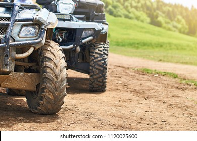 Quadricycles or quadbikes on the ground road in summer mountains