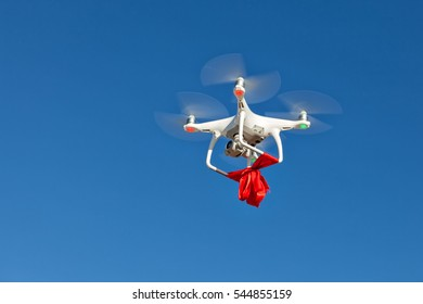 Quadrocopter with ribbon flying high in the sky