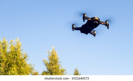 a quadrocopter with a video camera flies over the forest