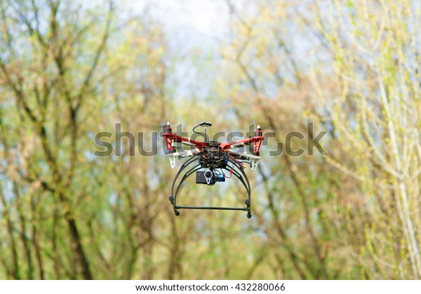 Quadrocopter while flying in the forest.