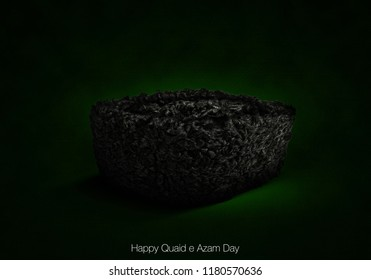 Quaid e Azam Day concept, Jinnah Karakul cap in black color on green textured background concept of happy 25th December.