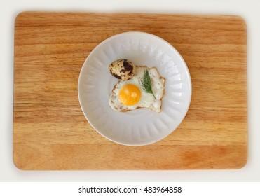 Quail egg on a saucer flat lay